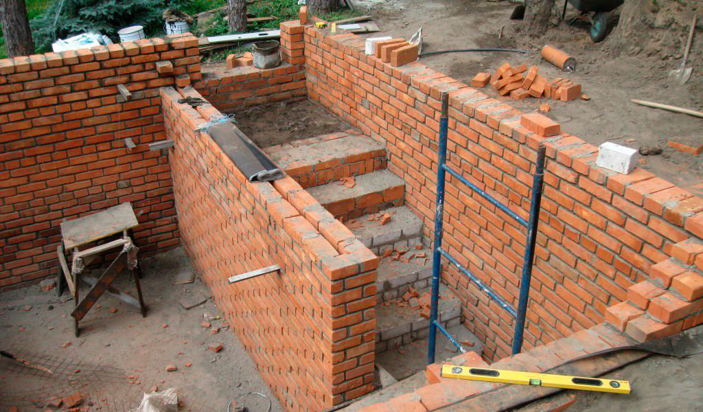 может поэтапное строительство дома из кирпича фото касается